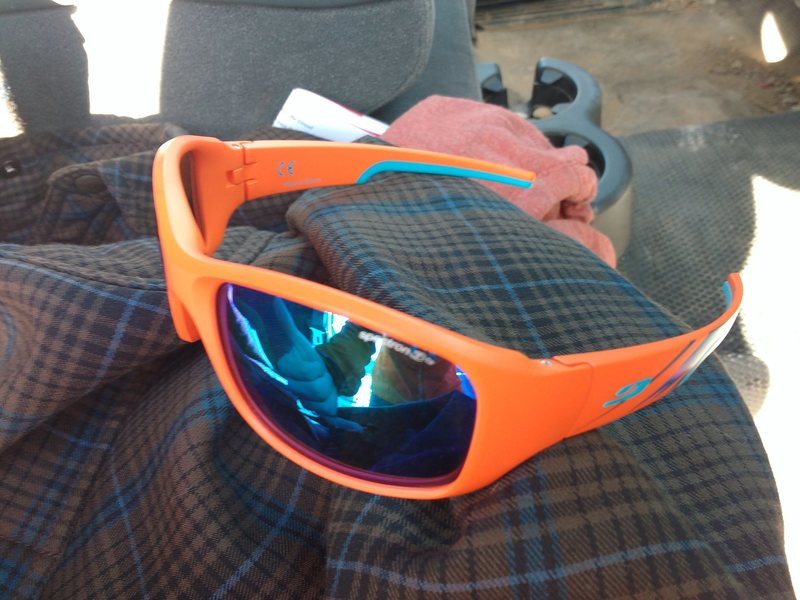 $50 Julbo Dust.  Worn maybe 3 times. Includes hard and soft case.  Too big for my tiny dome.