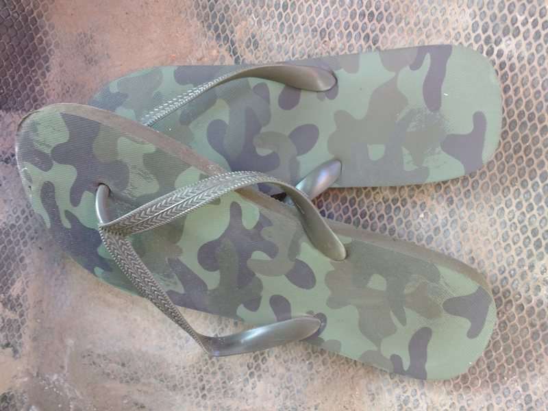 $5 Camo flip flops. Size 11 or 12.  Look bad-ass in front of yo frenz