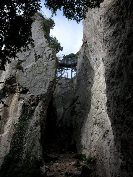 Climbing at Za Stolpom (wall to the right) with the Turški stolp (Turkish tower) to the left.