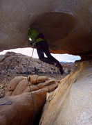 Rock Climbing Photo: Emily threading through the rock hole, across the ...