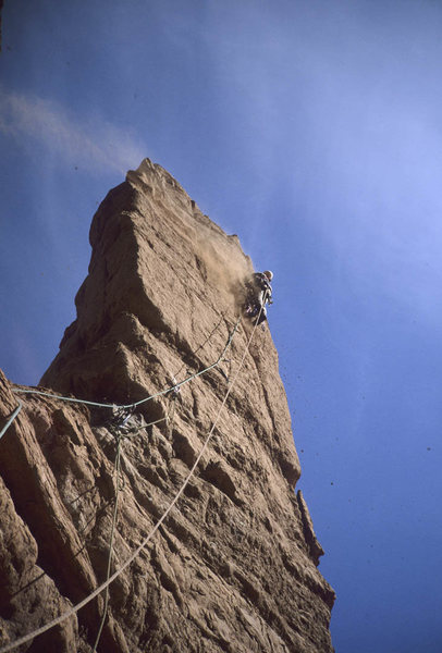 Strappo leading Pitch 3. Note dust plume. It was a windy day