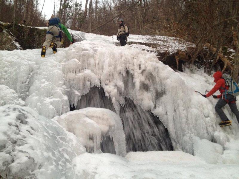 Scrambling around a window to the fall beneath the ice