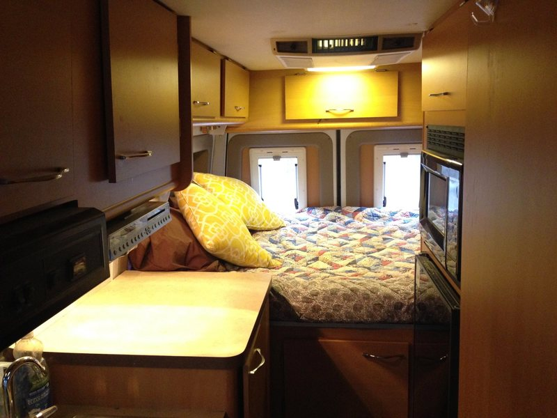 Bed at back of RV.