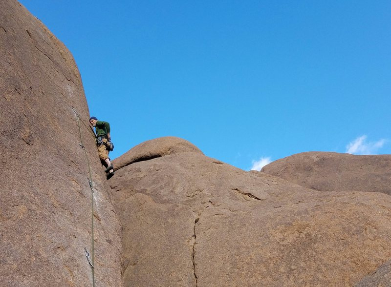 Brent Bingham on the first ascent. Thin edges on a slab. Perfect warm up for Cochise Stronghold!