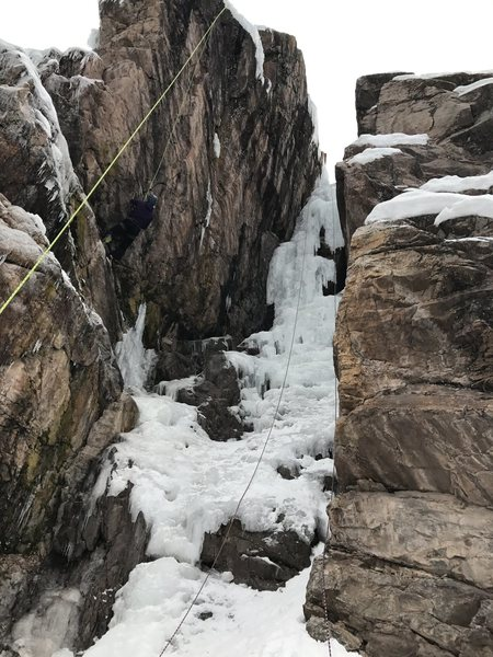 "Ach Mon as of 21 January 2017 at the Ouray Ice Fest. Most veer left, but if you want to make it ""spicy"", get on the free hanging pillar to the right."