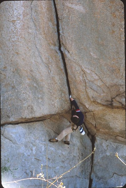 Scott McCook bouldering out the start of Bushwhack Crack in the early 80s.