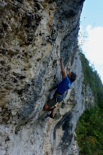 Taking another lap on Resistance at Caliche Crag in Ciales, Puerto Rico.