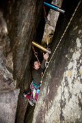 Rock Climbing Photo: Sierra locked off on solid knees to clean the gear...