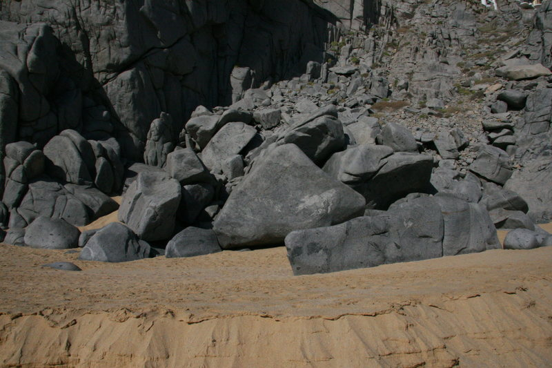 The boulders where the small roof is located. Roof is seen on the right of photo.