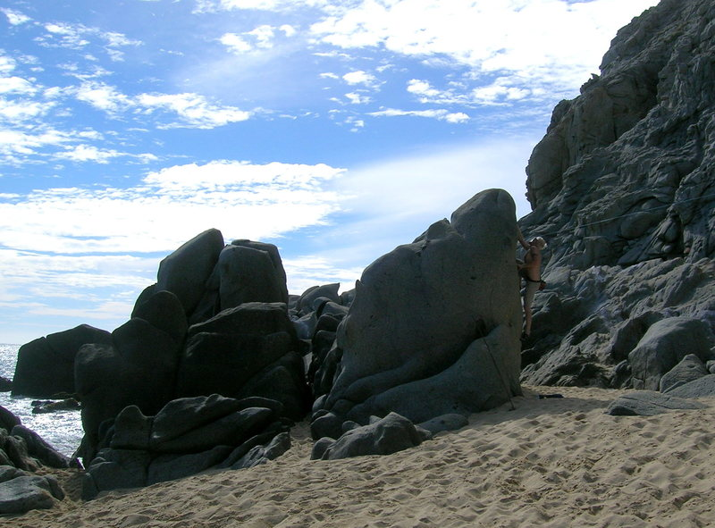 A nice V4ish problem that is no more. It is now gravel under the resort on the west end of Solmar Beach.