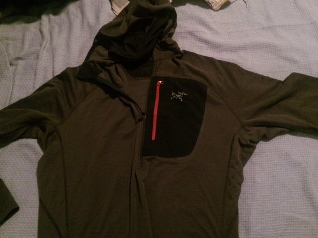 Arcteryx Hoodie. <br> <br> This jacket is L, but runs a little small. Thumb holes, super breathable (loose weave) and a built in balaclava<br> $75