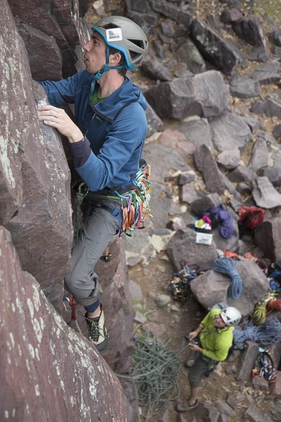 Ben Smith works his way up the friendly twin cracks of Sunken Pillar with Erik Shepard on catch duty.
