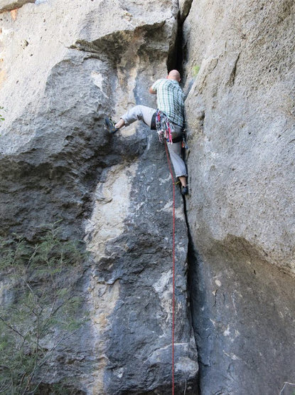 Climber starting at the base of Texas 2-Step