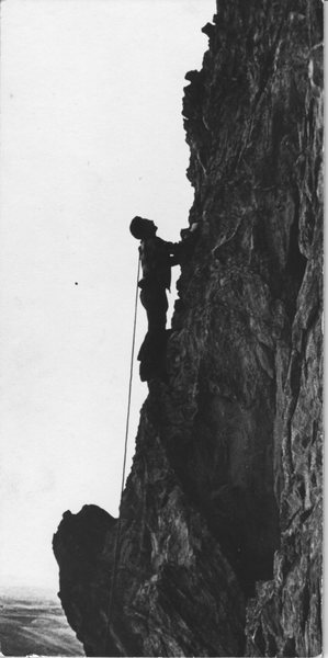 Vern Twombly on Kindergarten Rock in 1945. I think this is the North Ridge. He climbed in leather sole army boots and used saddle cinch rings and rope slings in lieu of biners. The rope is over his shoulder to avoid the rings sliding down the rope.