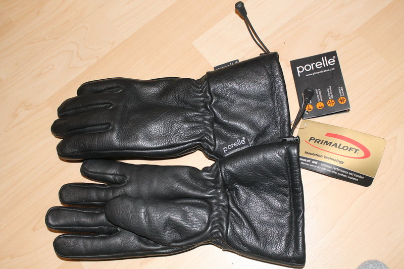 NEW 100% leather glove with Primaloft and Porelle breathable-waterproof membrane.<br> XL but feel like Medium.<br> 35$