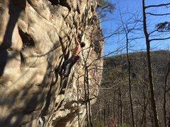 Climber on initial crux section of Cracker Jack Kid.