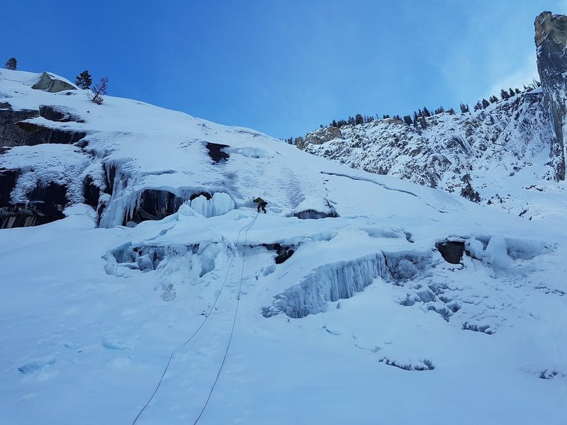 Middle section WI4. Leading this would be risky due to aerated ice and snow mixed to make the ice rather lackluster.