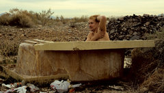 Somewhere outside of Vegas- arriving in the wee hours from Ventura we found a quiet bivvy spot.  Turned out it was an old dump.  Craig Smith taking advantage of the amenities.  Circa 1988.