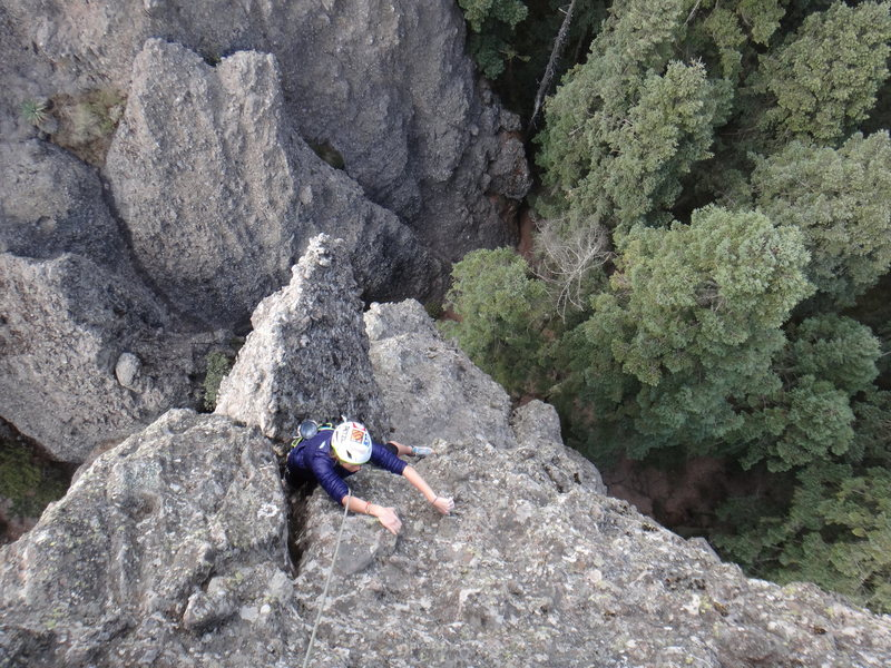 Hillary Allen making the step across move on the 2nd pitch of the Regular Route on El Fistol del Diablo.<br> <br> Photo by Mauricio Herrera Cuadra.