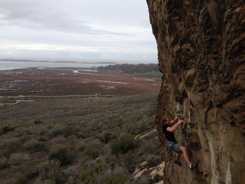 John Hickey feeling the crux on Olas Negras. Photo by Aaron Formella, 01-10-2016