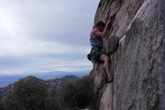 Me struggling through the brutal start to this fun slabby route