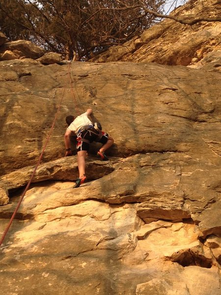 Bryce grabs the crimp at the crux to seal his first asct