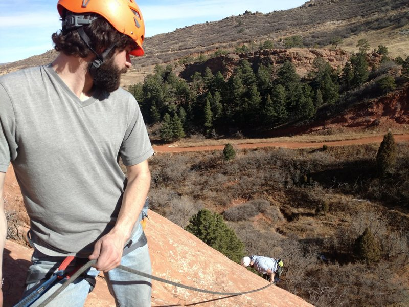 Anthony belaying Drew to the top of Coyote Wall.