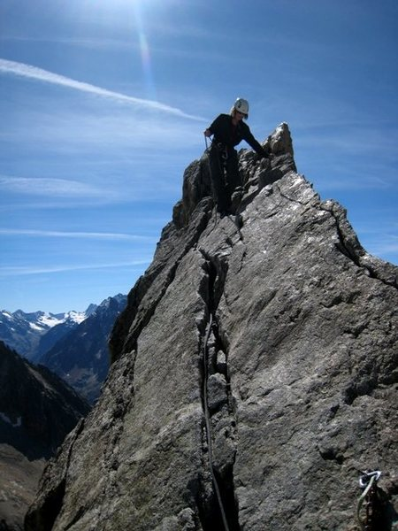 Patty Black on the summit of Aiguille Dibona after Voie du Nain and a finish of the Route Normale