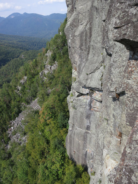 Climber on P1 of Weekend Warrior. Shows the scale of the Upper Washbowl.