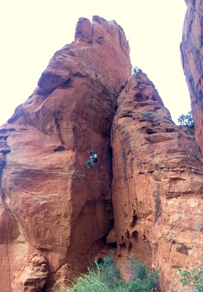Bean rappelling the normal route on the Dorsal Fin. See route page for topo overlay.