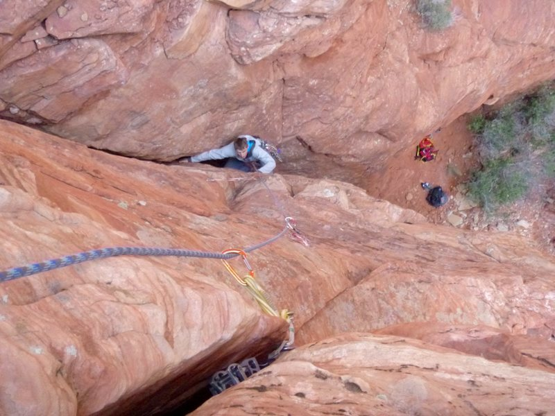 Bean exiting the flared offwidth, getting ready for the face climbing!<br> <br> That #4 in the crack is a little tight. Much better to save a #3 for that part.