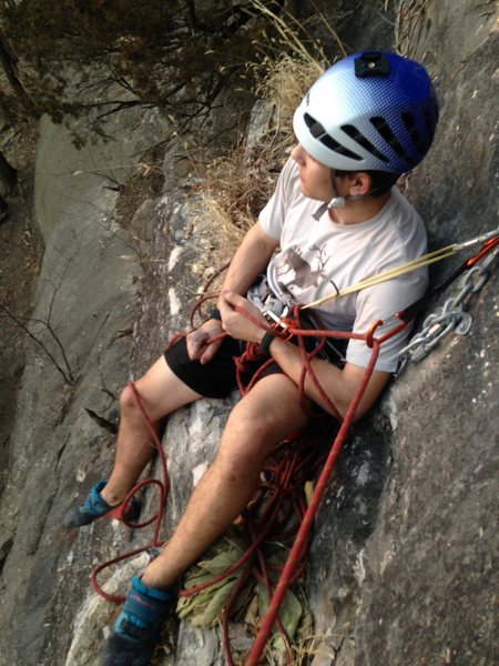 Belay sitting down at the first rap anchors, or use the next bolt up as a directional