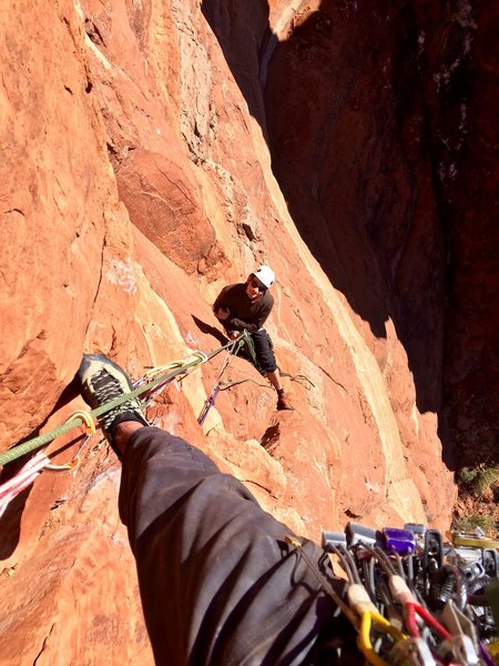 Starting the second pitch, looking down at Ray on belay.