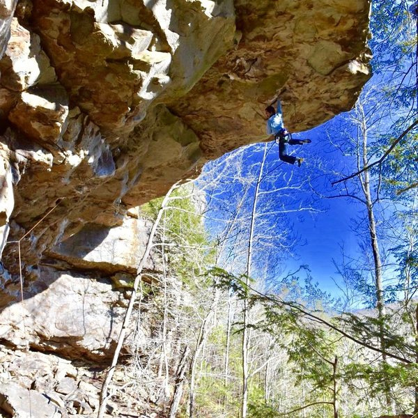 Neil Chugh sticking the deadpoint move on Solstice 5.12a