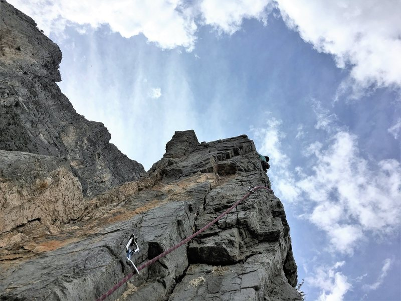Further up on the amazing fourth pitch.  Take a right at the second bolt and prepare for exposure. Photo by Adrian Burke