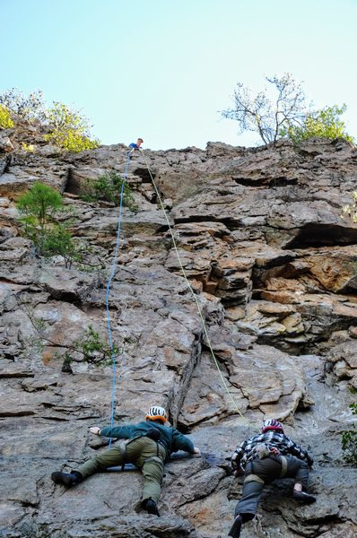 Bro and cousin racing up the wall on top belay.