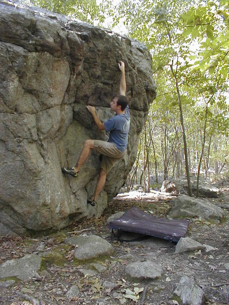 Joe McLoughlin warming up on the Ames Boulder.