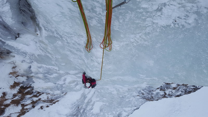 Constance crushing it on the top of pitch 1. The first 40 meters only took a couple stubby screws in the thickest ice. Higher on the wall protection got better.
