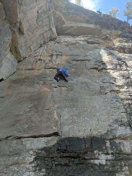 Keith moves like a graceful ninja as he traverses out right to a tiny crimp at the crux