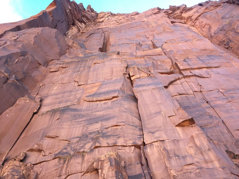 Looking up at the Voodoo Child area of the wall. The 5.10 start to Super Natural and Spirit World is in the bottom center. The prominent corner of the second pitch of Super Natural is on the left side of the photo..