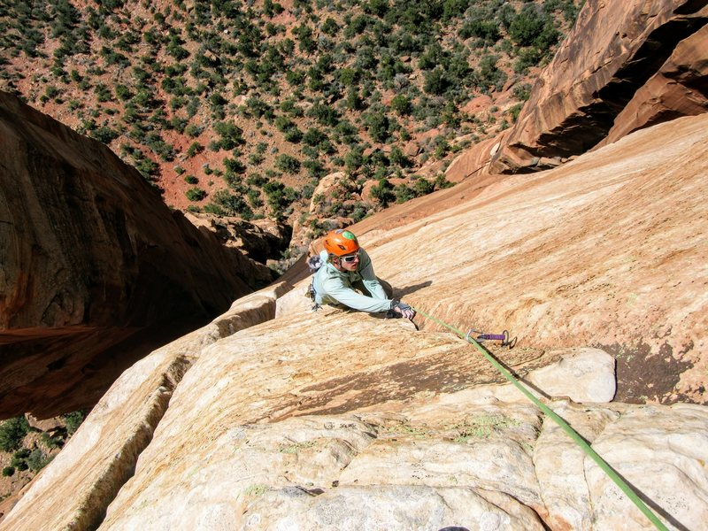 Neil Kauffman finishes up the 5.9 flake on P5 of Lovelace with the Fang Spire behind left.