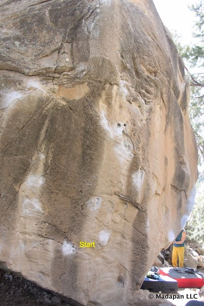 Start in three finger pocket and crimp and move up solid holds to a solid mantle