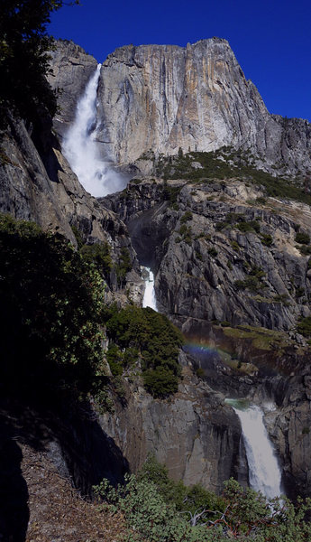 Elevated view of Upper and Lower Yosemite Falls, with a Middle as well.  After topout via The Caverns (or Hanging Teeth), go ccw via 4th class to climber&@POUND@39@SEMICOLON@s right, up thru a manzanita patch near end, to a cliffed out perch.