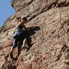 Jessica Lam climbing on top tope