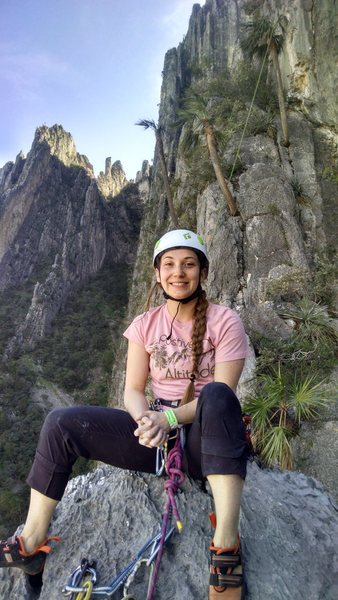 "KLS at the top of ""Will the Wolf Survive"". Climbers are rappelling down from ""Estrellita"" behind her"