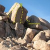 Human Sacrifice Boulder, Joshua Tree NP<br> <br> A. Defenders of the Farce (5.10a R)<br> B. Dictators of Anarchy (aka The Skinhead Arete) (5.12c)<br> C. New World Order (5.13b A0)<br> D. Human Sacrifice (5.11c)