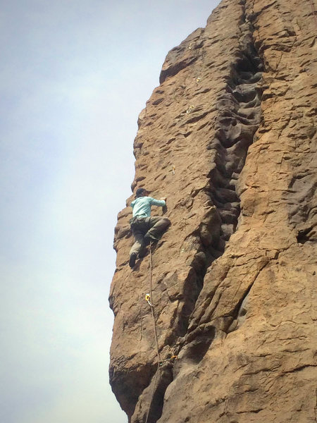 Mid-way up the face on the FA, crux is at the small overhang above.