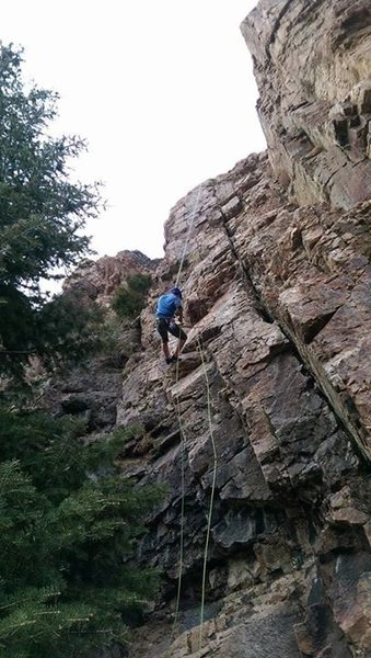 Coming down after climbing one of my uncles old FA's. He says stay off the crack or it's a 5.7