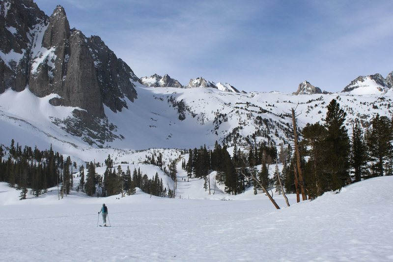ski touring across second lake, with the temple crag in the background