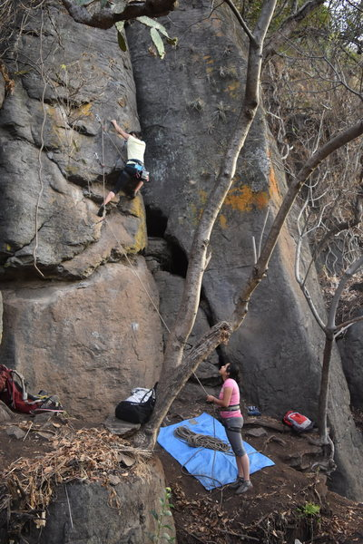 xochilth rodriguez getting ready for the crux of the route.